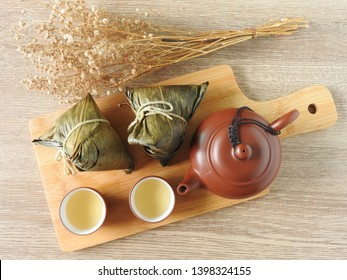 Top view of zongzi also called  rice dumplings or sticky rice dumplings on wooden background. Dragon boat festival is a traditional festival of East Asian culture. Chinese tea. Food concept.