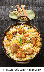 Top view-Delicious seer fish pilaf or biriyani cooked with basmati rice ,Indian spices and herbs,Selective focus photograph.
