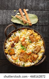 Top view-Delicious seer fish pilaf or biriyani cooked with basmati rice ,Indian spices and herbs,.Selective focus photograph.