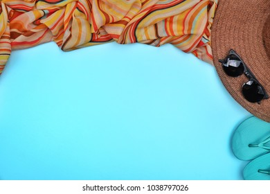 Top view,Flat lay of sandal beach Craft hat ,multi color scarf,sunglasses on indigo blue pastel background with copy space,blank for text.Hipster vacation,Day off holiday traval theme.Summer Concept.