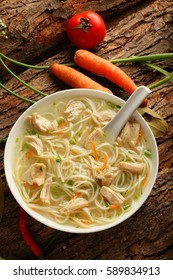 Top view-Homemade tasty Chicken noodle cream soup in white bowl.