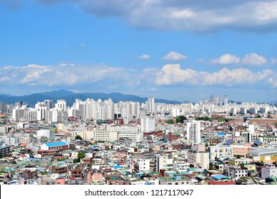 Top views of beautiful Daegu city against blue sky and white clouds, this place is one of the famous tourist destination in Daegu, South Korea country. Traveling style and holidays concept.