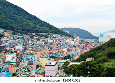 Top views of Gamcheon Culture Village (Korea's Santorini) or Taeguekdo Village with green mountains, this place is one of famous tourist destination in Busan, South Korea. Travel and holiday concept.