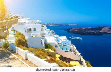 top of the volcanic mountain of Santorini, Fira, with tourists walking the streets, view of volcanic caldera, Santorini, Greece
