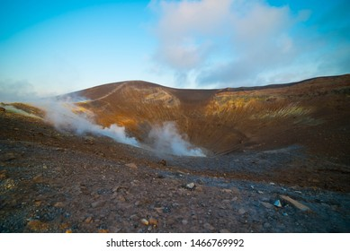 at the top of the volcano island among the phosphorus fumes