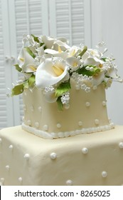 Top of wedding cake in subdued romantic lighting
