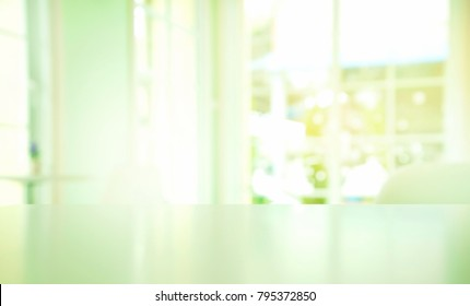 top of white green blue table with blur summer light from window in interior home living room in clean cozy style background