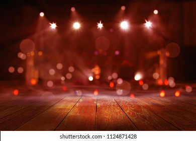 top wood desk with light bokeh in concert blur background,wooden table
