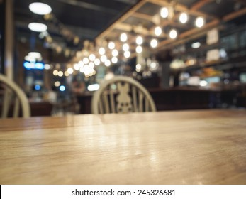 Top of Wood Table with Bar Restaurant blurred background