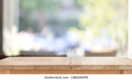 Top wood table in living room window background