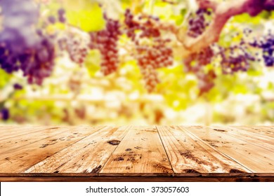 Top of wood table with vineyard background - Empty ready for your product display montage.