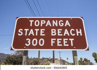Topanga State Beach sign on Pacific Coast Highway in Malibu, California.