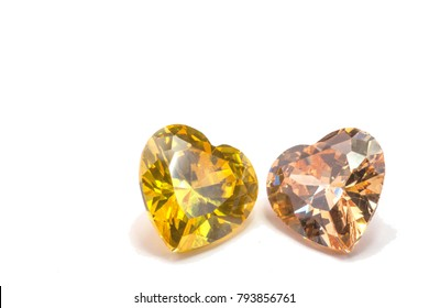 topaz gemstones in heart shape on white background. The most valuable colors of Topaz are the golden orange to yellow type