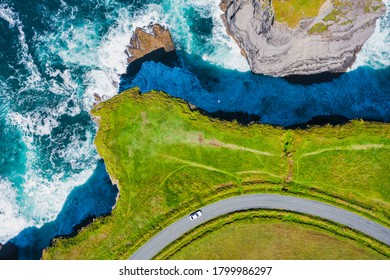 Top-down aerial view over the Irish rugged coastline at Kilkee Cliffs, Co Clare. Epic Irish  Seascape along the wild Atlantic way.The natural beauty of the cliff edge and the blue Atlantic ocean.