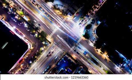 Top-down view of beautiful light trails on the crossroads at night time in Jakarta city