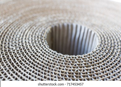 Top-down view of rolled up cardboard at an angle