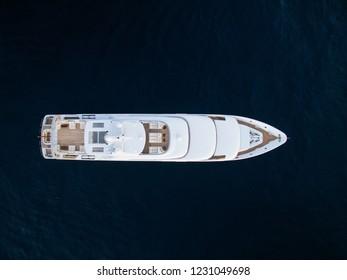 Top-down view of white luxury motor yacht in ocean