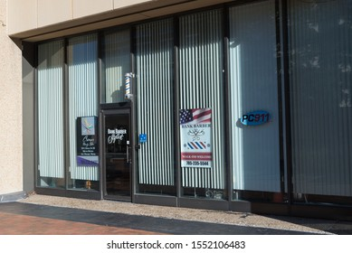Topeka, Kansas / United States of America - November 2nd 2019 : Main entrance and exterior to Bank Barber Stylist in downtown Topeka.  Glass windows with shades drawn, local business.