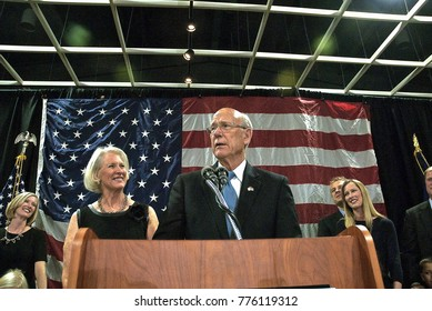 Topeka, Kansas, USA, 4th, November, 2014 Senator Pat Roberts with his wife Franki at his side with the rest of their family behind them on stage at the Republican victory celebration in Topeka.
