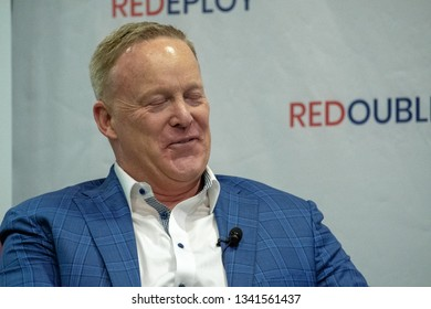 Topeka, Kansas, USA, February 16, 2019 Former White House press secretary Sean Spicer is interviewed by Robba Moran after participating in a book signing at the annual Kansas GOP convention