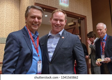 Topeka, Kansas, USA, February 16, 2019Former Kansas Governor Jeff Colyer and freshman congressman Steve Watkins of the 2nd district get together during the annual GOP convention