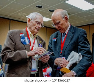 Topeka, Kansas, USA, February 16, 2019Senator Pat Roberts speaks with his long time director of special projects Harold Stones at the annual Kansas state GOP convention