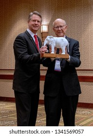 Topeka, Kansas, USA, February 16, 2019Senator Pat Roberts and Congressman Roger Marshall pose with a model elephant the symbol of the Republican party at the annual Kansas state GOP convention