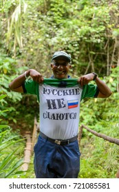 TOPES DE COLLANTES, CUBA - SEP 8, 2017: Unidentified Cuban man with a shirt and inscription Russians don't give up in Topes de Collantes, a nature reserve park in  Cuba.
