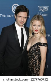 Topher Grace and Ashley Grace at the Art Of Elysium's 12th Annual Heaven Celebration held at the Private Venue in Los Angeles, USA on January 5, 2019.