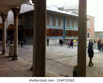 Topkapi Palace, Istanbul, Turkey - December 29, 2013: Watching the visitors through the historical colums pf the palace.