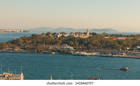 Topkapi Palace near Eminonu in Istanbul. The prince islands are visible in the backside of Topkapi Palace. Ferries are passing. Istanbul Golden Horn View with Topkapi Palace.