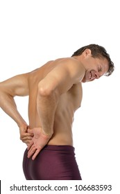 Topless athletic male suffering from excruciating lower back pain