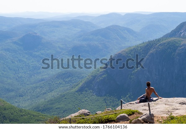 topless-man-admiring-view-summit-600w-17