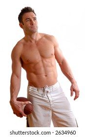 topless man with a football in his hand