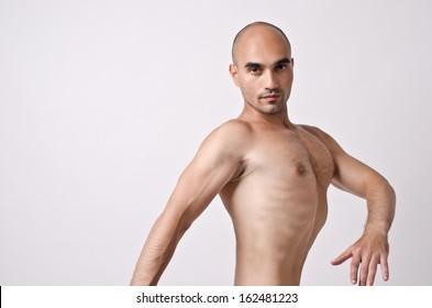 Topless man posing weird, enhancing his chest. Fit circus dancer training. Stripper dancing.
