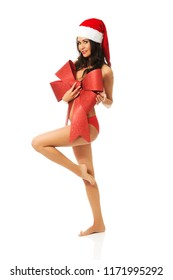 Topless santa woman covering her body by ribbon