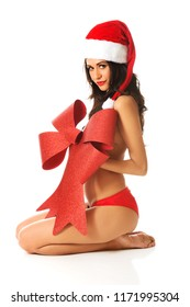 Topless santa woman sitting and covering her body by ribbon