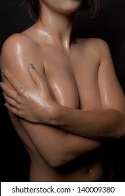 Topless Woman With Oil and Water