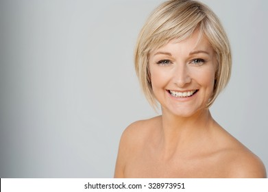 Topless woman posing over grey background