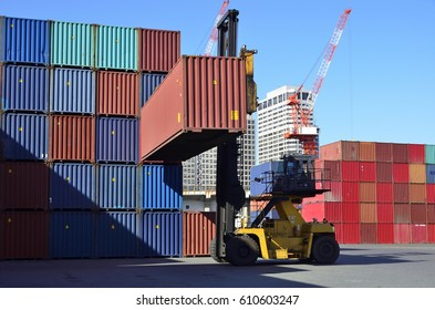 Toplifter handling cargo container loading to container trailer in import export logistic zone