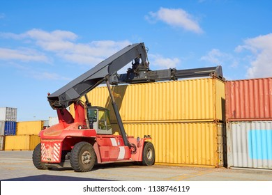 Toplifter working with cargo container in port