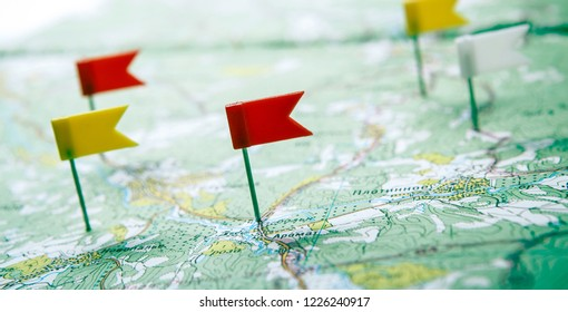 topographic map with flag pushpins close up