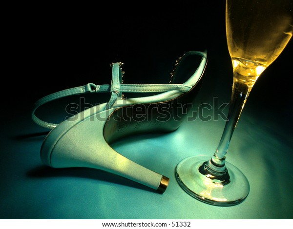 A toppled high heel and a champagne flute.