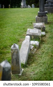 toppled tombstones in a historic graveyard - portrait