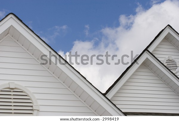 tops of home roof with sky background