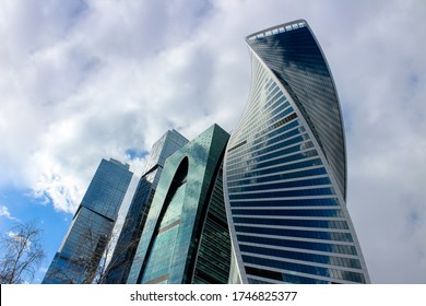 Tops of modern corporate buildings against the gloomy sky. High-rise buildings and skyscrapers Moscow International Business Center (Moscow City), Russia.