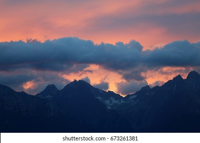 The tops of the mountains at sunset