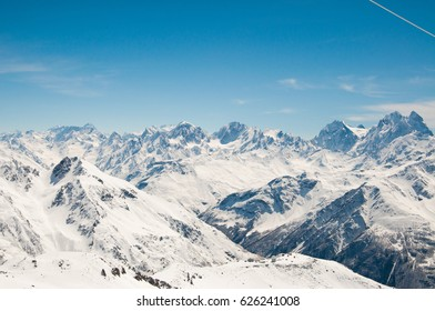 Tops of winter snow-capped mountains of the ski resort of the Caucasian range