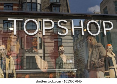 Topshop retail sign shop window with the street reflecting off the glass. London - 12th September 2020