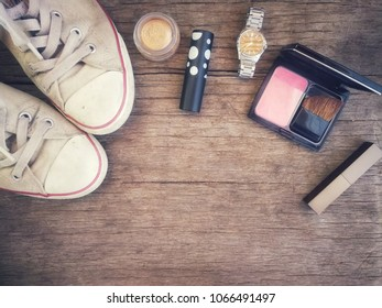 Topview of cosmetic makeup collection warm tone for sumer look on wood table background,vintage tone.